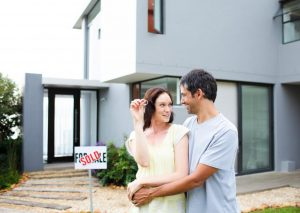 happy-couple-after-buying-house