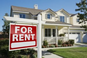 for-rent-real-estate-sign-in-front-of-house