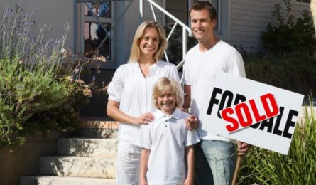 happy-family-in-front-of-their-new-house